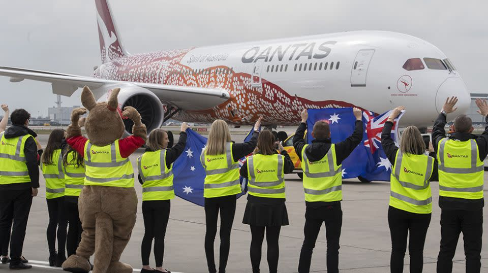 Qantas staff wave goodbye to flight QF10 as she leaves the gate from Heathrow en route to Perth. Source: Getty