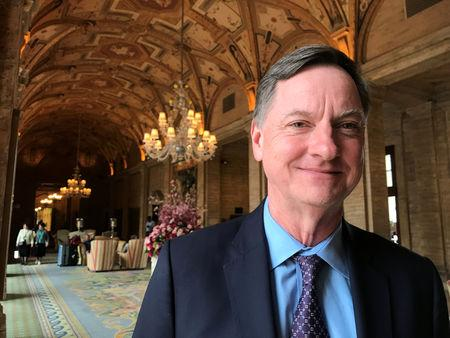 FILE PHOTO: Charles Evans, president of the Federal Reserve Bank of Chicago, poses for a photo in Palm Beach, Florida, U.S. January 17, 2018.  REUTERS/Ann Saphir