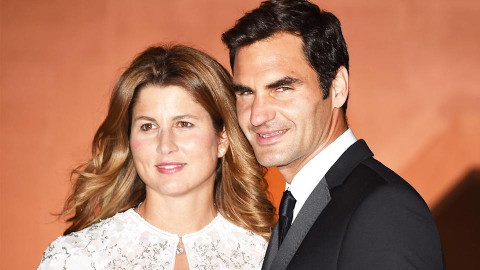 Roger and Mirka Federer take photos as they arrive at the Wimbledon Champions Dinner 2017.