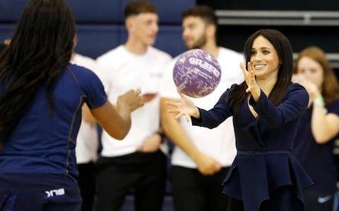 The Duchess played in high heels and a trouser suit - Credit: Eddie Mulholland For The Telegraph