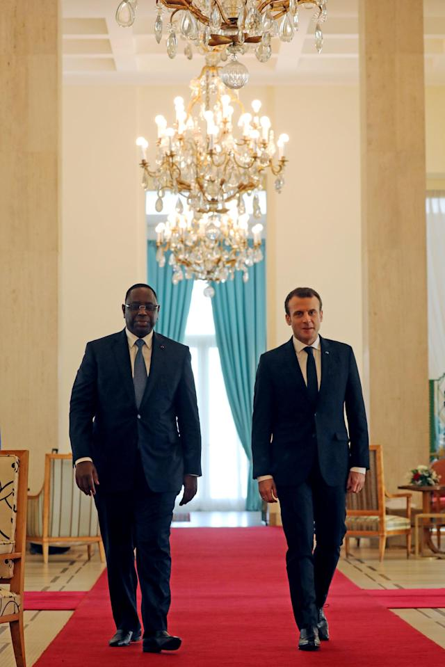 Senegalese President Macky Sall and French President Emmanuel Macron arrive for a ceremony at the presidential palace in Dakar, Senegal, February 2, 2018. REUTERS/Ludovic Marin/Pool