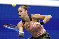 Maria Sakkari, of Greece, returns to Bianca Andreescu, of Canada, during the fourth round of the US Open tennis championships, Monday, Sept. 6, 2021, in New York. (AP Photo/John Minchillo)