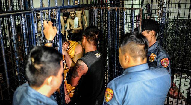 Drug suspects are led into a crowded jail cell on June 20, 2016 in Manila, Philippines. Photo: Getty Images/Dondi Tawatao