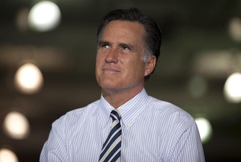 Republican presidential candidate, former Massachusetts Gov. Mitt Romney pauses during a town hall meeting at Ariel Corporation, Wednesday, Oct. 10, 2012, in Mt. Vernon, Ohio. (AP Photo/ Evan Vucci)
