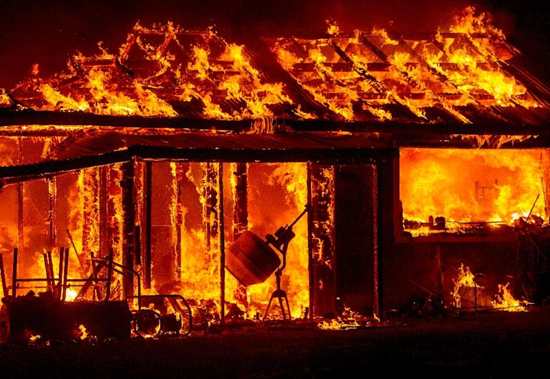 A house is engulfed in flames during the Valley fire in Seigler Springs, California on September 13, 2015 (AFP Photo/Josh Edelson)