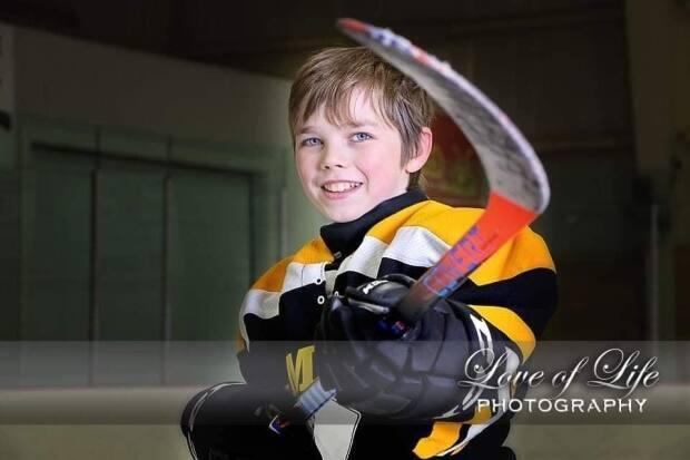 Austin Keough loved hockey and played for Tignish, says his aunt Jennifer Rozell.  (Love of Life Hockey - image credit)