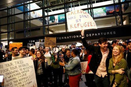 People protest against U.S. President Donald Trump's travel ban on Muslim majority countries at the International terminal at Los Angeles International Airport (LAX) in Los Angeles, California, U.S., January 28, 2017. REUTERS/Patrick T. Fallon
