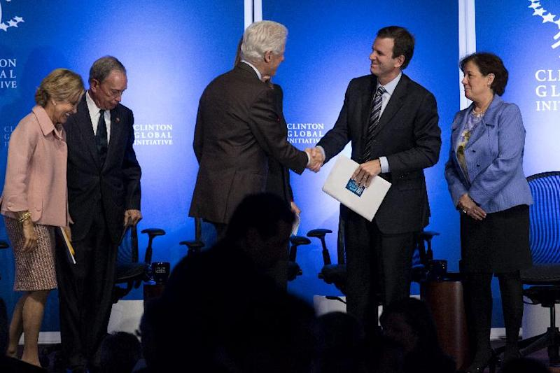 Former President Bill Clinton shakes hands with Rio de Janiero Mayor Eduardo Paes at the Clinton Global Initiative (CGI) Mid-Year Meeting Monday, May 6, 2013 in New York.Details for CGI Latin America and a new commitment from the C40 Climate Leadership Group in partnership with the Clinton Foundation were announced at the event. From left are panelists Judith Rodin, President, The Rockefeller Foundation; New York Mayor Michael Bloomberg, and far right is Mindy Lubber, President and CEO, Ceres. (AP Photo/Craig Ruttle)