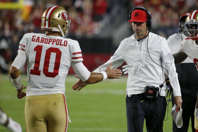 San Francisco 49ers quarterback Jimmy Garoppolo (10) greets head coach Kyle Shanahan after a touchdown. (AP Photo/Rick Scuteri)