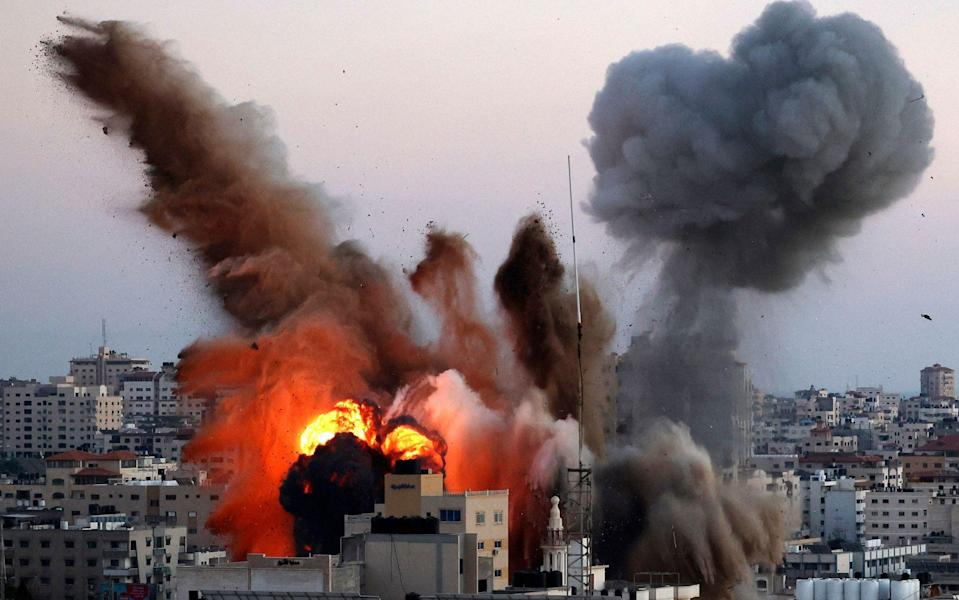 Smoke billows after an Israeli airstrike on Gaza City targeted the Ansar compound, linked to the Hamas movement, in the Gaza Strip - MAHMUD HAMS/AFP