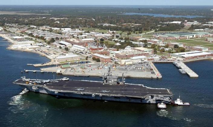 The USS John F. Kennedy is pictured in 2004 at the Naval Air Station in Pensacola, Florida, where a shooter was killed after opening fire on December 6, 2019 (AFP Photo/PATRICK NICHOLS)