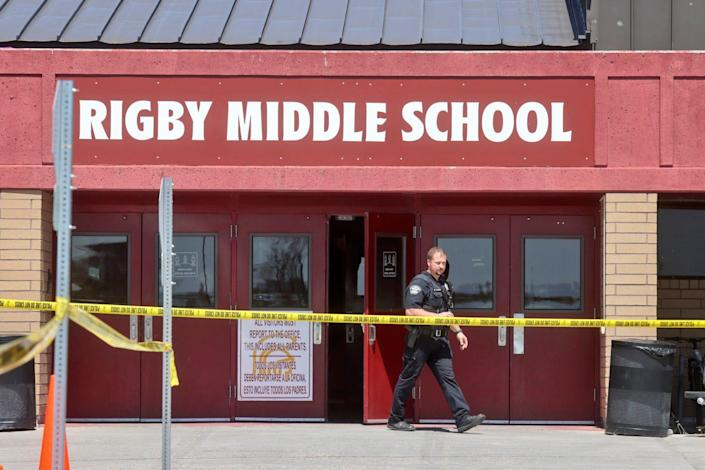 A police officer walks out of Rigby Middle School following a shooting there earlier Thursday.