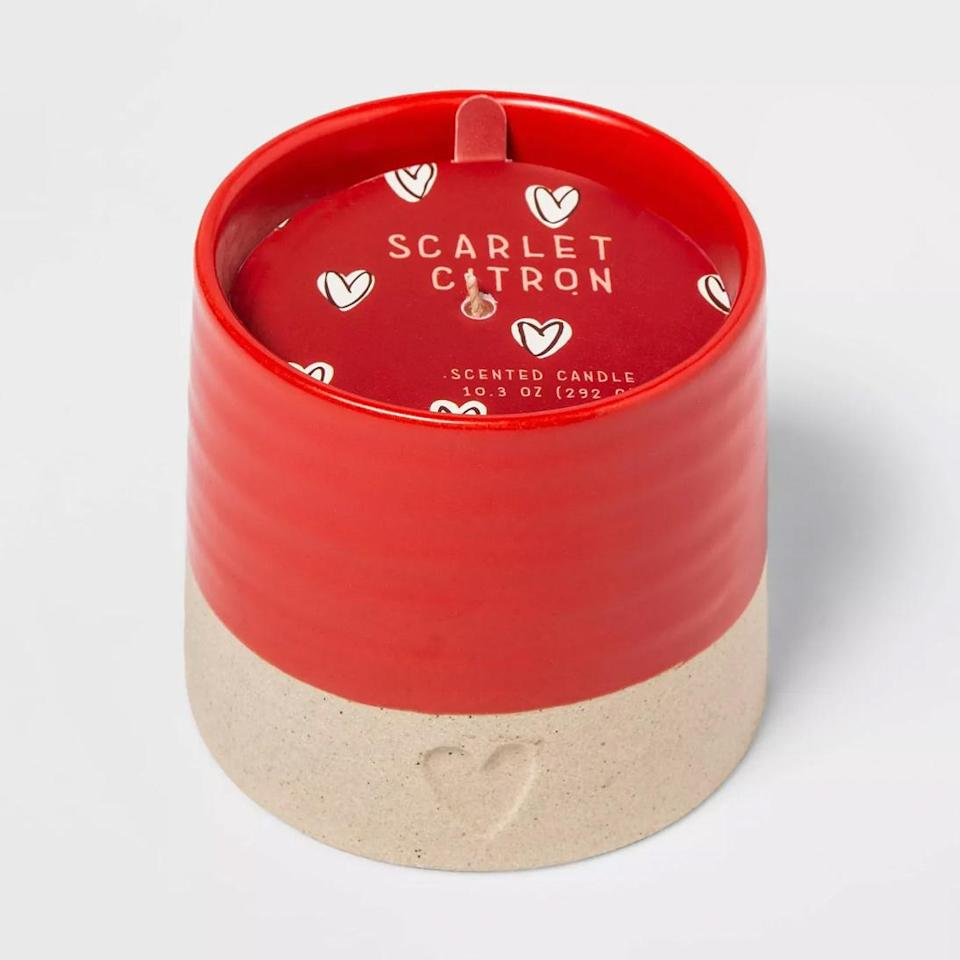 """<p>Imbued with notes of fig, citrus, hyacinth, lemon and rose, this single-wick candle comes in the cutest red-and-beige ceramic jar imprinted with a dainty heart. </p> <p><strong>Buy It!</strong> $12, <a href=""""https://goto.target.com/c/249354/81938/2092?subId1=PEOTheBestValentinesInspiredCandlesfortheSingleorTakenCandleLoverInYourLifehchubbHomGal12564975202102I&u=https%3A%2F%2Fwww.target.com%2Fp%2F10-3oz-valentine-39-s-ceramic-scarlet-citron-candle-opalhouse-8482%2F-%2FA-80183788%3Fref%3Dtgt_adv_XS000000%26amp%3BAFID%3D"""" rel=""""nofollow noopener"""" target=""""_blank"""" data-ylk=""""slk:target.com"""" class=""""link rapid-noclick-resp"""">target.com</a></p>"""