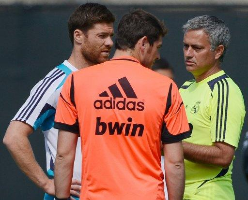 """Jose Mourinho (right) speaks with goalkeeper Iker Casillas (centre) and midfielder Xabi Alonso during a training session in Los Angeles, California, on August 1. Last season Mourinho became the first coach to win Spanish, Italian and English titles leading him to suggest a change to the nickname given to him in Britain -- """"the special one"""""""