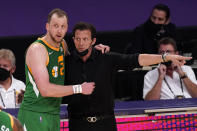 Utah Jazz guard Joe Ingles, left, talks with head coach Quin Snyder during the second half of an NBA basketball game against the Los Angeles Lakers Saturday, April 17, 2021, in Los Angeles. (AP Photo/Mark J. Terrill)