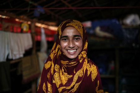 Formin Akter, a Rohingya refugee girl, smiles as she poses for a picture before heading to Chittagong to attend school at the Asian University for Women, in Cox's Bazar, Bangladesh, August 24, 2018. REUTERS/Mohammad Ponir Hossain