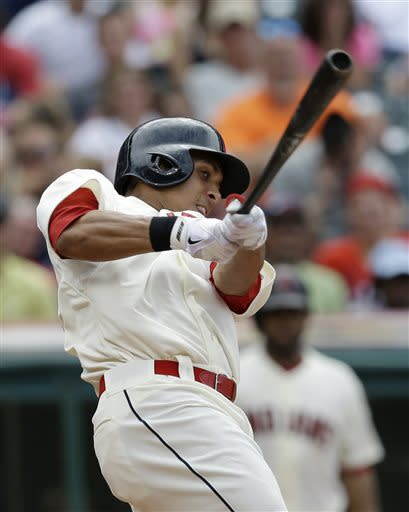 Cleveland Indians' Michael Brantley hits a two-run home run off Detroit Tigers relief pitcher Al Alburquerque in the eighth inning of a baseball game, Sunday, July 7, 2013, in Cleveland. Nick Swisher scored. (AP Photo/Tony Dejak)