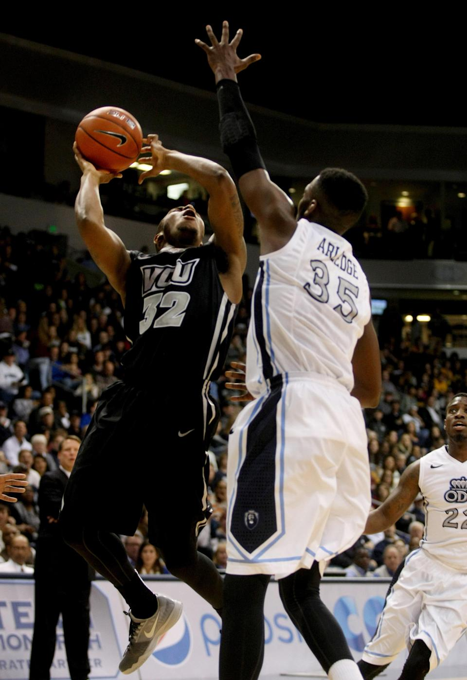 Virginia Commonwealth's Melvin Johnson (32) shoots over Old Dominion's Jonathan Arledge (35) during the first half of their NCAA college basketball game, Saturday, Nov. 29, 2014 at the Constant Center in Norfolk, Va. (AP Photo/Jason Hirschfeld)