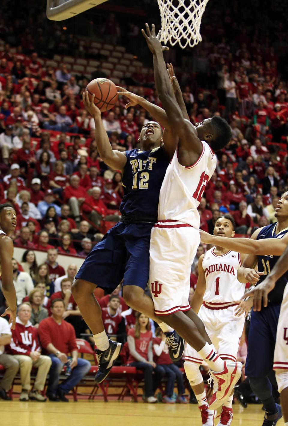 Pittsburgh's Chris Jones, left, puts up a shot against Indiana's Hanner Mosquera-Perea during the first half of an NCAA college basketball game Tuesday, Dec. 2, 2014, in Bloomington, Ind. (AP Photo/Darron Cummings)