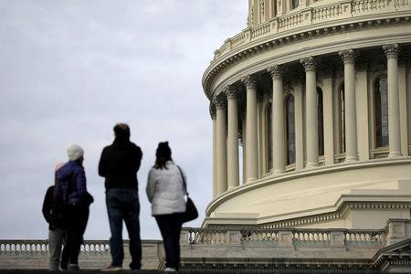 Tourists stand by the U.S. Capitol during the third day of a government shutdown in Washington, U.S. January 22, 2018. REUTERS/Carlos Barria