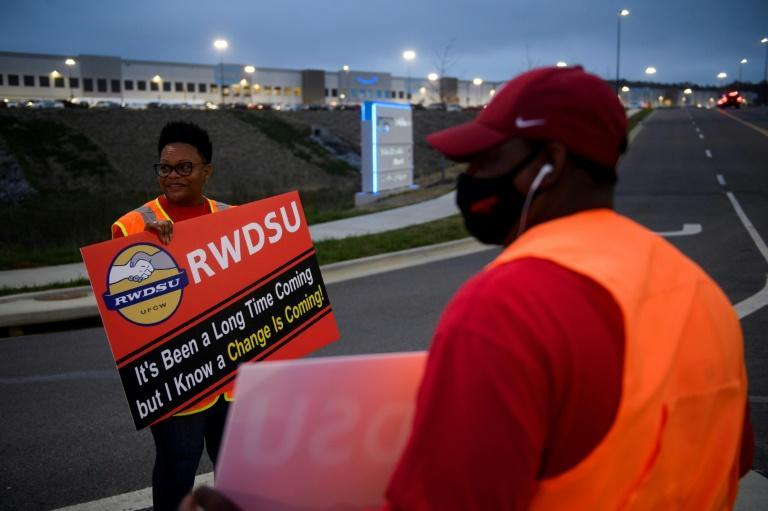 Union activists greet workers arriving at the Amazon plant in Bessemer, Alabama