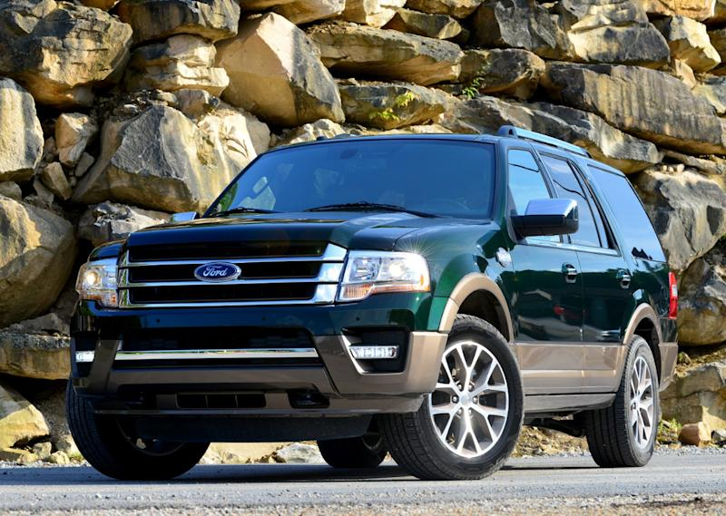 A green 2016 Ford Expedition, a large SUV.