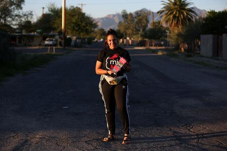 Volunteer Bea Nevarez stands for a portrait during door-to-door canvassing in Tucson, Arizona, U.S., October 31, 2018. Picture taken October 31, 2018. REUTERS/Caitlin O'Hara