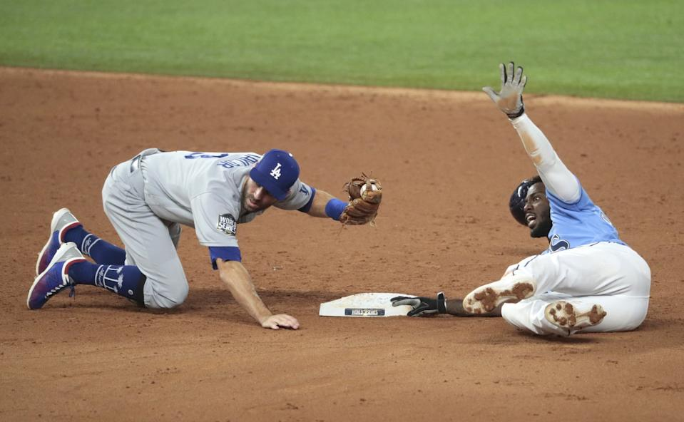 Chris Taylor tags out Tampa Bay Rays' Randy Arozarena during the third inning.