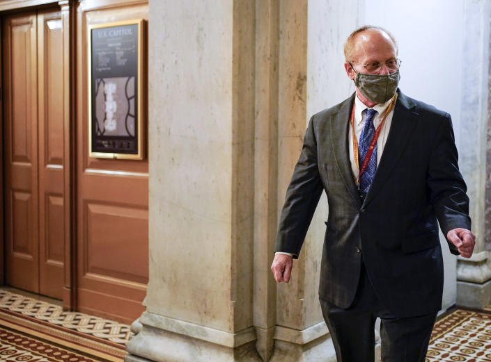 David Schoen, lawyer for former President Donald Trump, walks on Capitol Hill during a break in the second impeachment trial of Trump, at the Capitol, Wednesday, Feb. 10, 2021 in Washington. (Joshua Roberts/Pool via AP)