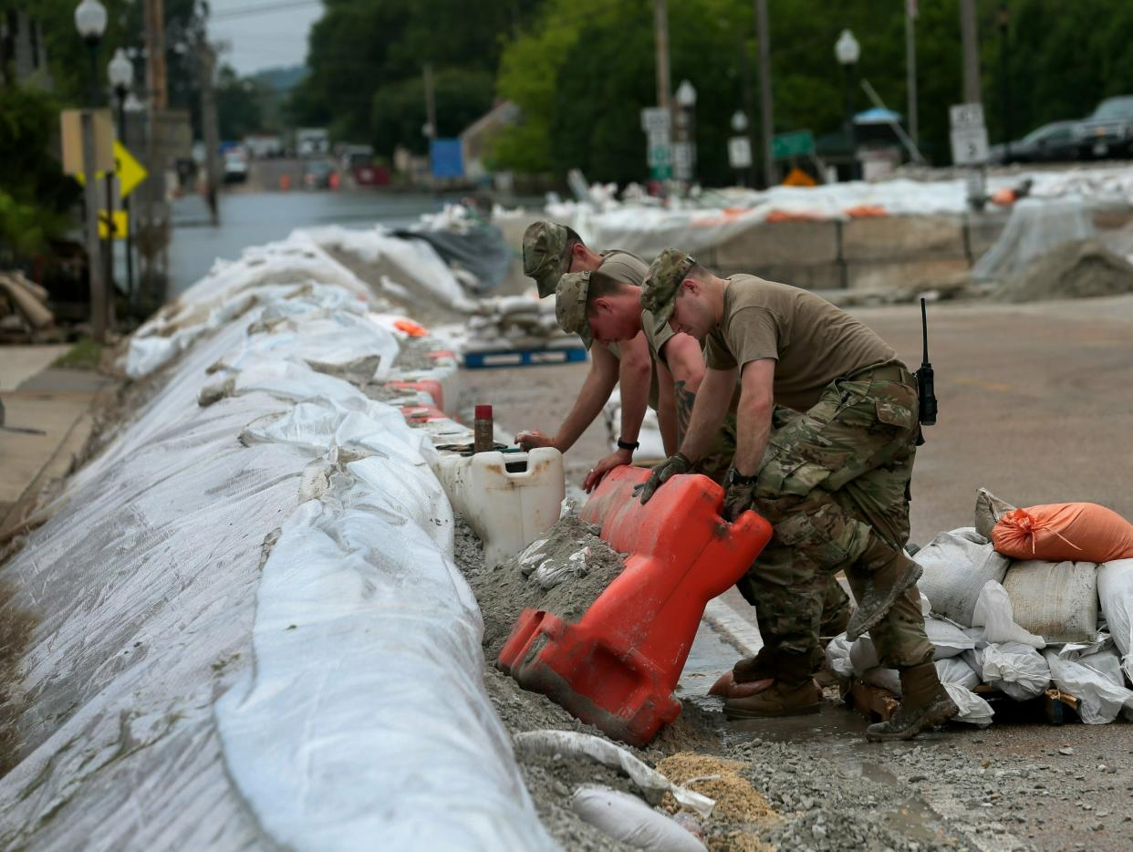 Members of the 233rd Military Police out of Springfield, Illinois, take down the most eastern portion of the flood wall along Main Street on Wednesday, June 19, 2019, in Grafton. On Wednesday, the level of the Mississippi River was 30.2 feet, having dropped about five feet from its crest at 35.17 on June 7. (Photo: Laurie Skrivan/St. Louis Post-Dispatch via AP)