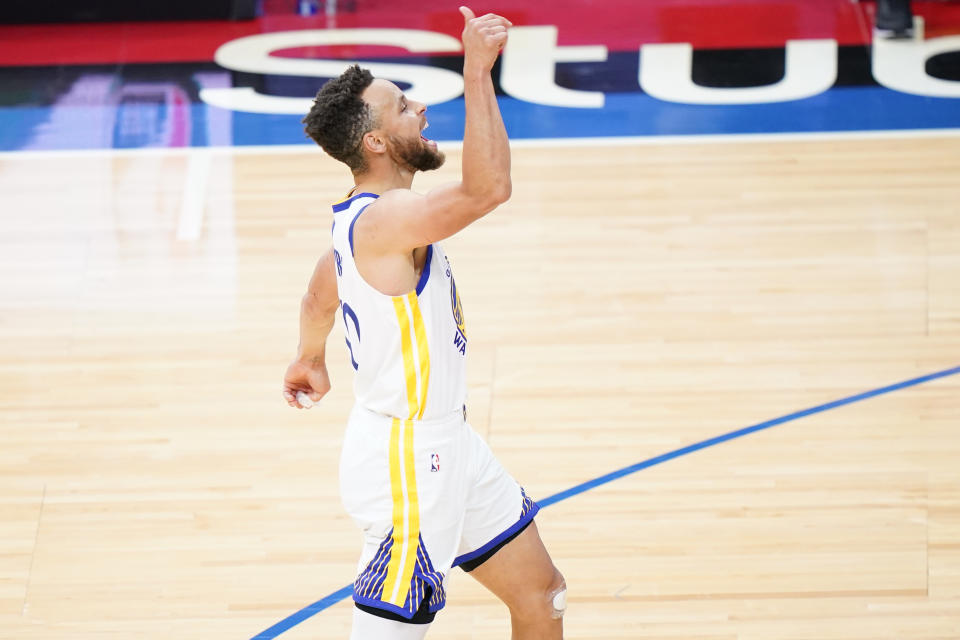 Golden State Warriors' Stephen Curry reacts after making a three-pointer during the second half of an NBA basketball game against the Philadelphia 76ers, Monday, April 19, 2021, in Philadelphia. (AP Photo/Matt Slocum)