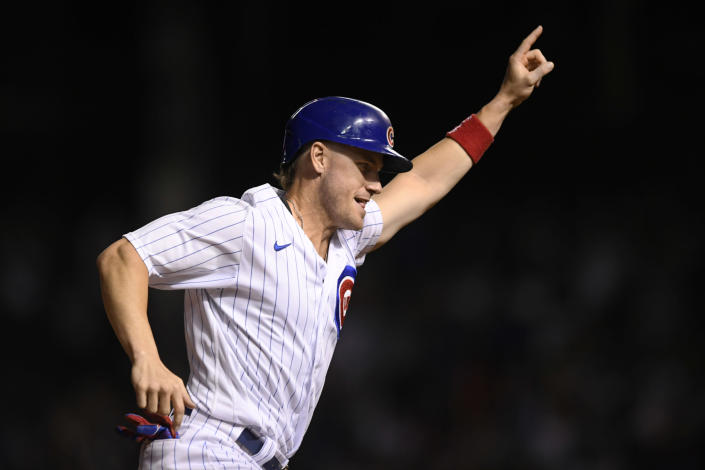 Chicago Cubs' Patrick Wisdom celebrates while rounding third base after Jason Heyward hit a game-ending, three-run home against the Cincinnati Reds during the 10th inning of a baseball game Wednesday, Sept. 8, 2021, in Chicago. The Cubs won 4-1. (AP Photo/Paul Beaty)