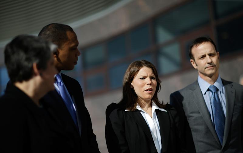 Former United States hockey player Caitlin Cahow, second from right, speaks during a news conference with fellow members of the U.S. delegation, from left, former Homeland Security Secretary Janet Napolitano and current President of the University of California, Assistant to the President and Deputy Chief of Staff for Policy Robert Nabors, and Olympic gold medal figure skater Brian Boitano, ahead of the opening ceremony at the 2014 Winter Olympics, Friday, Feb. 7, 2014, in Sochi, Russia. (AP Photo/David Goldman)