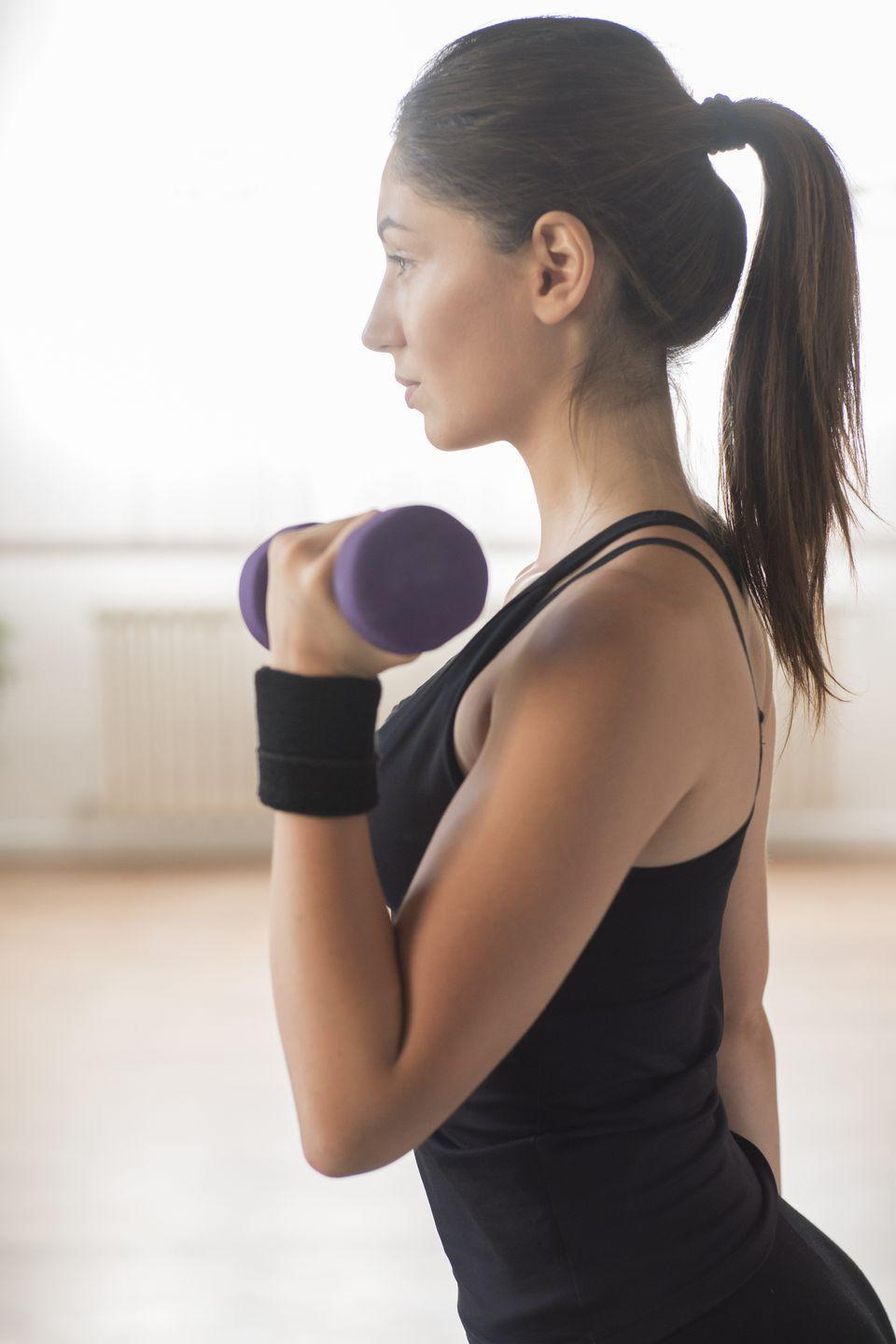 <p>Change up the standard shoulder press with this move that adds rotation and hits all angles of the deltoids. </p><p><strong>How to: </strong>Stand tall with feet hip-width apart and hold a dumbbell in each hand. Start with your arm bent and palm facing towards your shoulder, like you would at the top of a bicep curl. Press your arms up overhead but twist them on the way up so that your palms are facing away from you. Make sure to reach full extension where your biceps are touching your ears, then lower back down and repeat.</p>