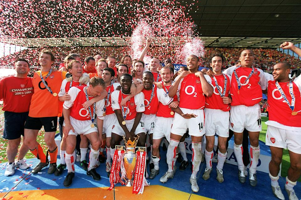 Arsenal Players celebrate beating Leicester City and winning the Premiership season on May 15, 2004 in London, United Kingdom.   (Photo by Stuart MacFarlane/Arsenal FC via Getty Images)