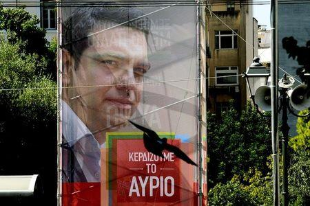 A banner showing former Greek Prime Minister Tsipras is seen in central Athens