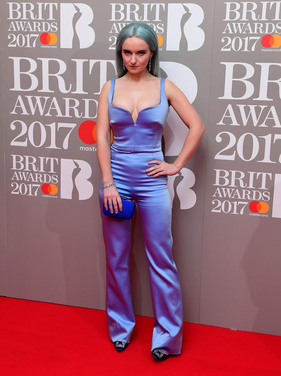 <p>The Clean Bandit member paired her mermaid hair with a satin lilac jumpsuit. <i>[Photo: PA]</i> </p>