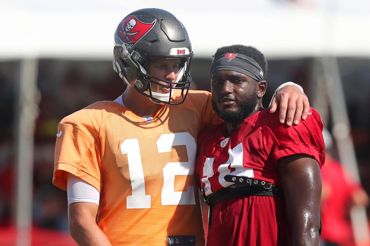 TAMPA, FL - AUG 18: Tom Brady (12) of the Buccaneers wraps his arm around Chris Godwin (14) during the Tennessee Titans &  Tampa Bay Buccaneers joint training camp on August 18, 2021 at the AdventHealth Training Center at One Buccaneer Place in Tampa, Florida. (Photo by Cliff Welch/Icon Sportswire via Getty Images)