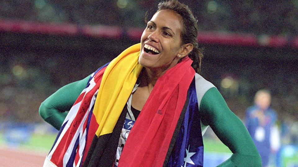 Cathy Freeman, pictured here after winning gold in the 400m at the 2000 Sydney Olympics.