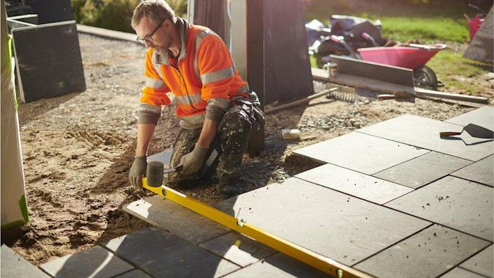 A man laying a patio