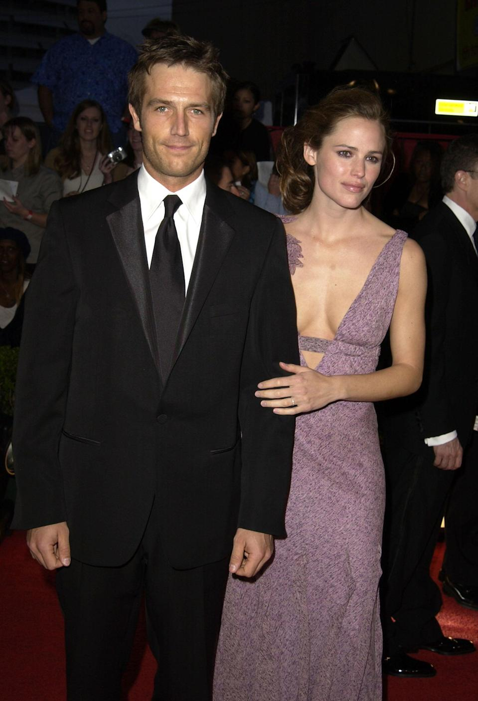 """<p>Jennifer and Michael first met on the set of <strong>Alias </strong>in 2001, though they didn't start dating until two years later. Their relationship only lasted until 2004, and the two both remained on the show - playing lovers Sydney and Michael - until its finale in 2006. </p> <p>In 2005, Michael told <strong>USA Today</strong> that <a href=""""http://usatoday30.usatoday.com/life/people/2005-05-12-vartan_x.htm"""" class=""""link rapid-noclick-resp"""" rel=""""nofollow noopener"""" target=""""_blank"""" data-ylk=""""slk:their breakup was &quot;benign&quot;"""">their breakup was """"benign""""</a> and that he and Jennifer decided they were """"better off as friends."""" They were so close that Jennifer even told Michael about her engagement to <a class=""""link rapid-noclick-resp"""" href=""""https://www.popsugar.com/Ben-Affleck"""" rel=""""nofollow noopener"""" target=""""_blank"""" data-ylk=""""slk:Ben Affleck"""">Ben Affleck</a> before the rest of the world found out. """"On the surface, it could have been a recipe for disaster,"""" he said of their on-set relationship following their breakup. """"But Jennifer and I were best friends first, during, and after.""""<br></p>"""