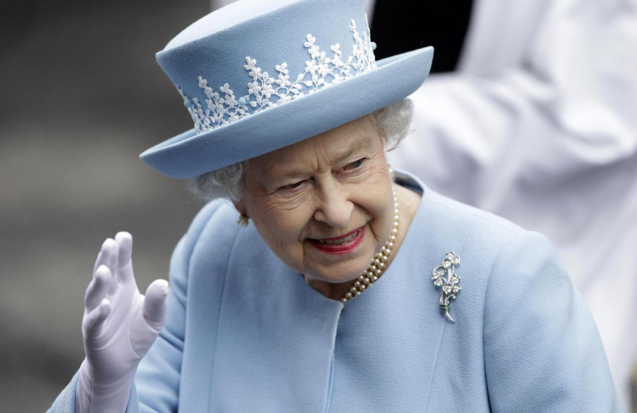 Britain's Queen Elizabeth II waves to the public as she arrives for a Service of Thanksgiving in Saint Macartin's Cathedral in Enniskillen, Northern Ireland, Tuesday, June 26, 2012. The Queen and the Duke of Edinburgh arrived in Northern Ireland for a two day visit to mark the Queen's Diamond Jubilee. (AP Photo/Peter Morrison)