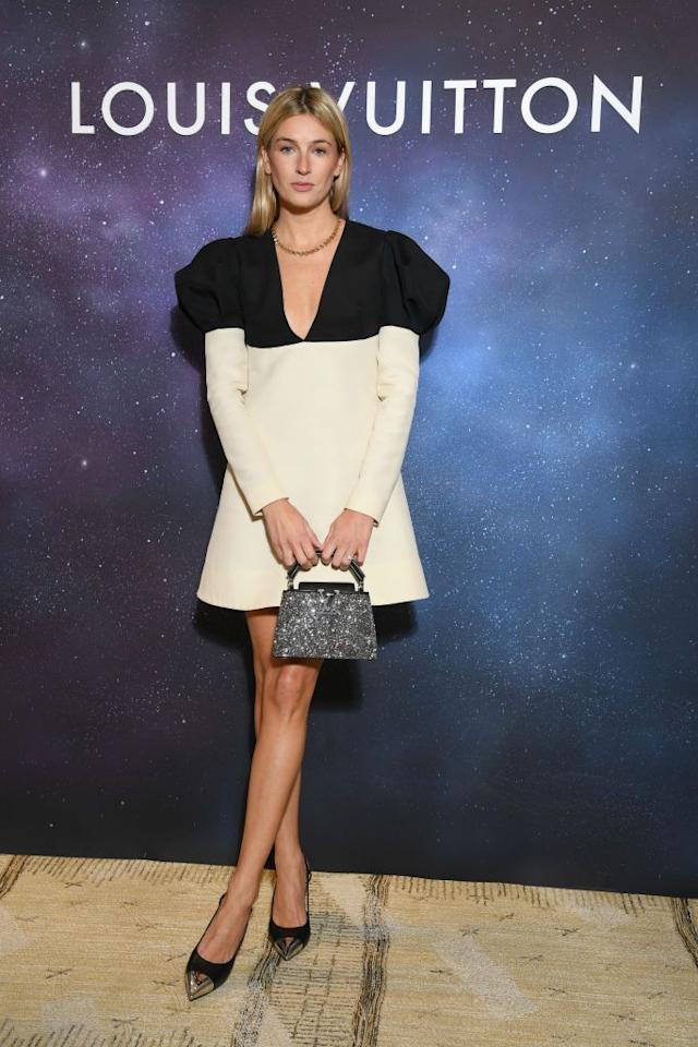 <p>The broadcaster wore a black and white mini dress to the Paris Fashion Week event.</p>