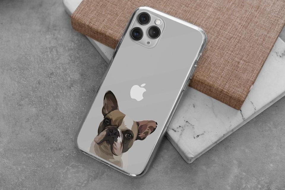 """<p><strong>West & Willow</strong></p><p>westandwillow.com</p><p><strong>$49.95</strong></p><p><a href=""""https://westandwillow.com/products/iphone-case"""" rel=""""nofollow noopener"""" target=""""_blank"""" data-ylk=""""slk:SHOP IT"""" class=""""link rapid-noclick-resp"""">SHOP IT</a></p><p>Custom pet portraits can run expensive—I am an expert on few things, but I have spent <em>hours</em> researching those—but West & Willow sells a whole line of chic merch with your pet's face on it, and (surprise!) it's all relatively affordable. This iPhone case, which comes complete with a custom illustration of your canine BFF, is my personal fave.</p>"""
