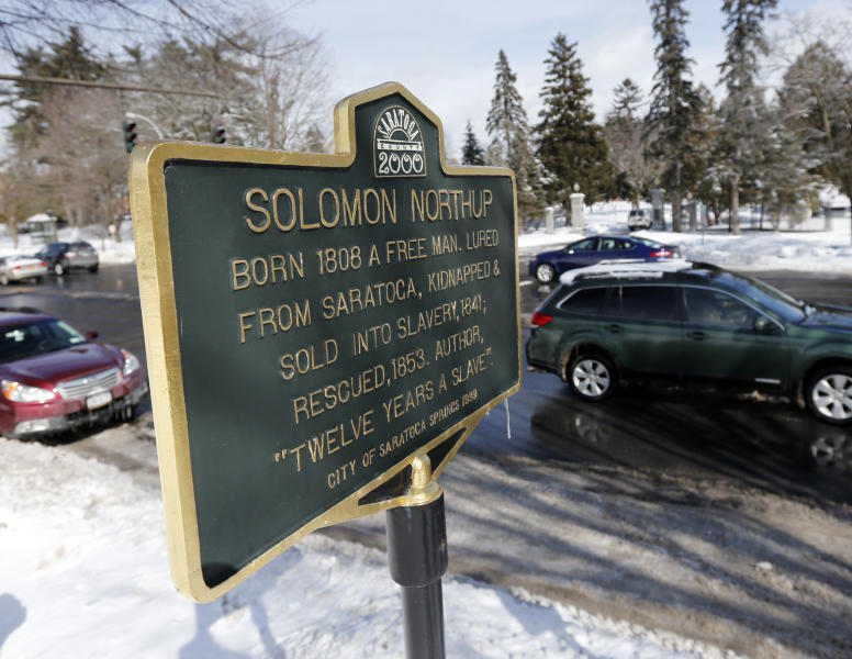 """A Solomon Northup historical marker is seen on Thursday, March 13, 2014, in Saratoga Springs, N.Y. Northup was the author of """"Twelve Years a Slave."""" (AP Photo/Mike Groll)"""