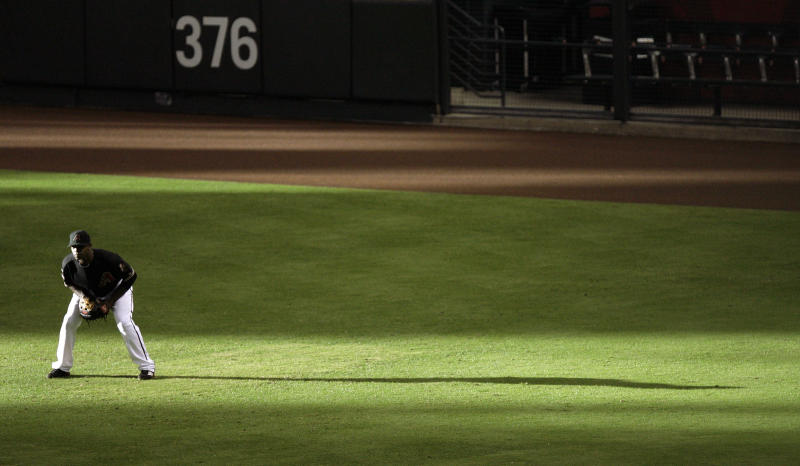 Arizona Diamondbacks right fielder Justin Upton readies himself for play as light streams through a window during a baseball game against the Washington Nationals in the fifth inning on Saturday, June 4, 2011, in Phoenix. (AP Photo/Paul Connors)