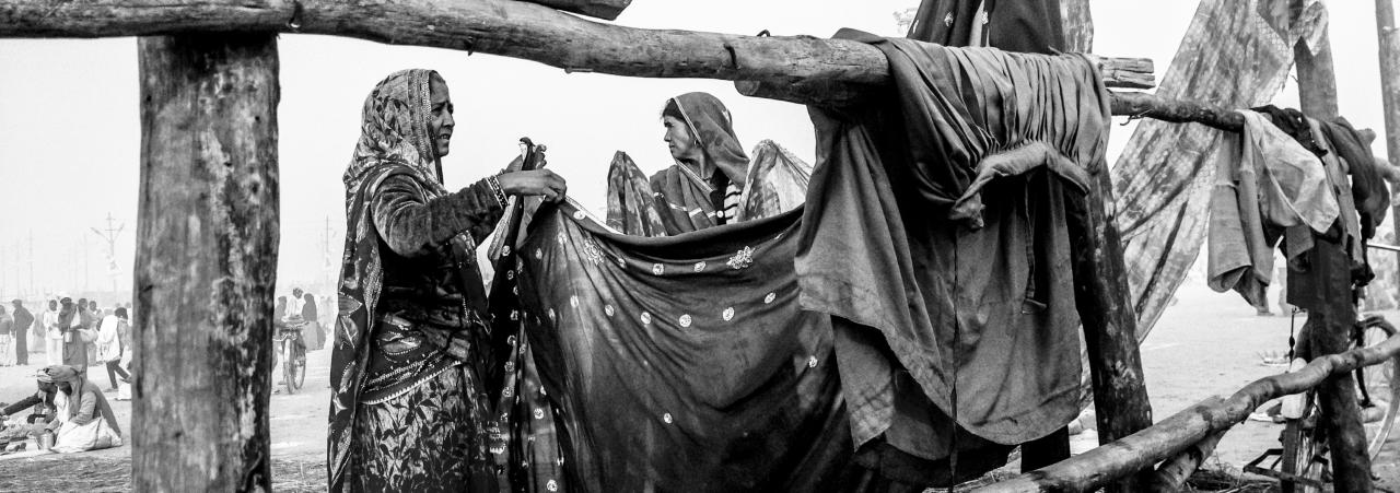 ALLAHABAD, INDIA - JANUARY 15: (EDITORS NOTE: Image was created using the iPhone panoramic application) Hindu devotees hang out saris to dry after having bathed on the banks of Sangam on January 15, 2013 in Allahabad, India. The Maha Kumbh Mela, believed to be the largest religious gathering on earth is held every 12 years on the banks of Sangam, the confluence of the holy rivers Ganga, Yamuna and the mythical Saraswati. The Kumbh Mela alternates between the cities of Nasik, Allahabad, Ujjain and Haridwar every three years. The Maha Kumbh Mela celebrated at the holy site of Sangam in Allahabad, is the largest and holiest, celebrated over 55 days, it is expected to attract over 100 million people. (Photo by Daniel Berehulak/Getty Images)