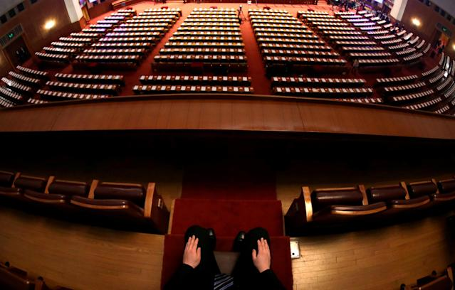 <p>A security worker sits at his post before the opening session of the National People's Congress (NPC) at the Great Hall of the People in Beijing on March 5, 2018. (Photo: Jason Lee/Reuters) </p>