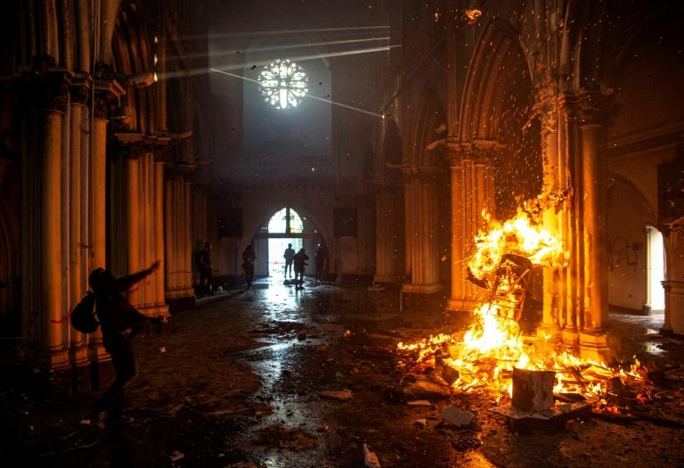 Churches burnt as thousands mark Chile protest movement anniversary