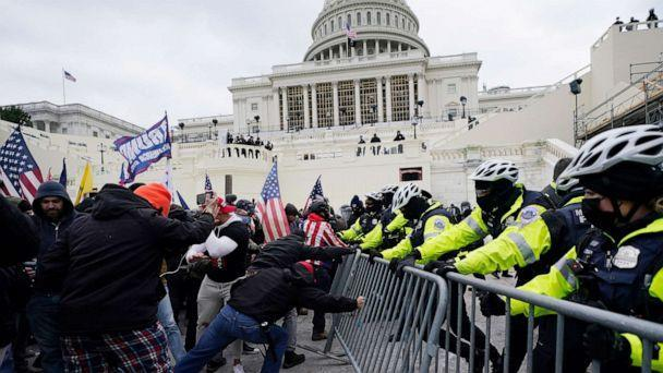 PHOTO: Rioters try to break through a police barrier at the Capitol, Jan. 6, 2021, in Washington D.C. (Julio Cortez/AP, FILE)